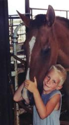 Photo of boy standing with horse