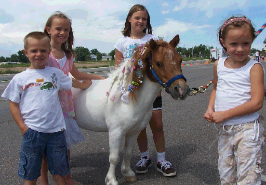 Photo of children with pony